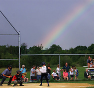 TOM BUSHEY/The Record.With a rainbow in the background, Monroe National plays Port Jervis in a District 19 Minor boys all-star game at the Minisink Valley Little League field on Monday, July 9, 2001..