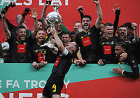 Football - 2019 / 2020 Buildbase FA Trophy - Final - Concord Rangers vs Harrogate Town - Wembley Stadium<br /> <br /> Harrogate Captain, Josh Falkingham lifts the trophy with his team mates behind<br /> <br /> Credit : COLORSPORT/ANDREW COWIE