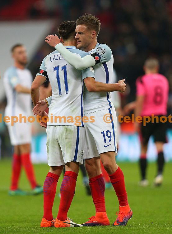 Wembley Stadium, London, UK.11th November 2016.  England's Jamie Vardy embraces Adam Lallana at the end of the FIFA World Cup Qualifier match between England and Scotland at Wembley Stadium in London. <br /> ©Telephoto Images / Alamy Live News