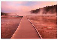 A deep red sunset with steam rising from the Grand Prismatic Spring at the The Midway Geyser Basin, Yellowstone National Park, Wyoming, USA