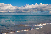 Grace Bay beach with surf, turquoise water, and clouds, Turks & Caicos