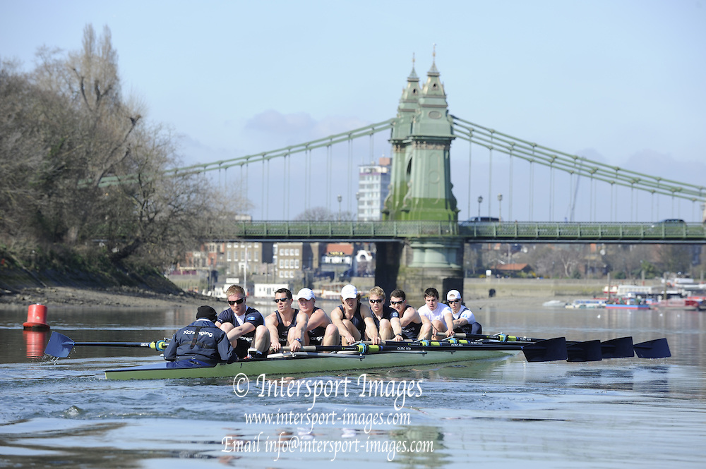 Putney. London. OUBC Blue Boat. approaches Hammersmith Bridge, during the morning training  session, Tideway Week - build up to the  2011 University Boat Race, Championship Course - Putney to Mortlake. Monday  21/03/2011 [Mandatory Credit; Peter Spurrier/Intersport-images]..OUBC. Bow; Moritz HAFNER, Ben MYERS, Alec DENT, Ben ELLISON, Karl HUDSPITH, Constantine LOULOUDIS, George WHITTAKER, Stroke Simon HISLOP and cox Sam WINTER-LEVY 2011 Tideway Week