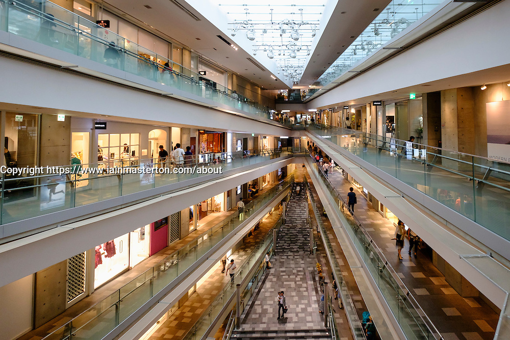 Interior of upmarket modern Omotesando Hills shopping mall in elegant Omotesando district of Tokyo Japan