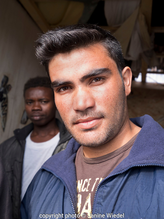 Young refugee  from Afghanistan living in The Calais Jungle fast realising the imposibility of ever reaching London