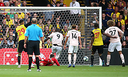 Manchester United's Romelu Lukaku (centre) scores his side's first goal of the game during the Premier League match at Vicarage Road, Watford
