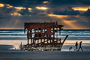 In 1906, the crew of the sailing ship Peter Iredale took refuge at Fort Stevens, after she ran aground on Clatsop Spit. The wreck is visible today, within Fort Stevens State Park, along the Oregon Coast, USA. Active from 1863–1947, Fort Stevens was an American military installation that guarded the mouth of the Columbia River in the state of Oregon. Built near the end of the American Civil War, it was named for a slain Civil War general and former Washington Territory governor, Isaac I. Stevens.