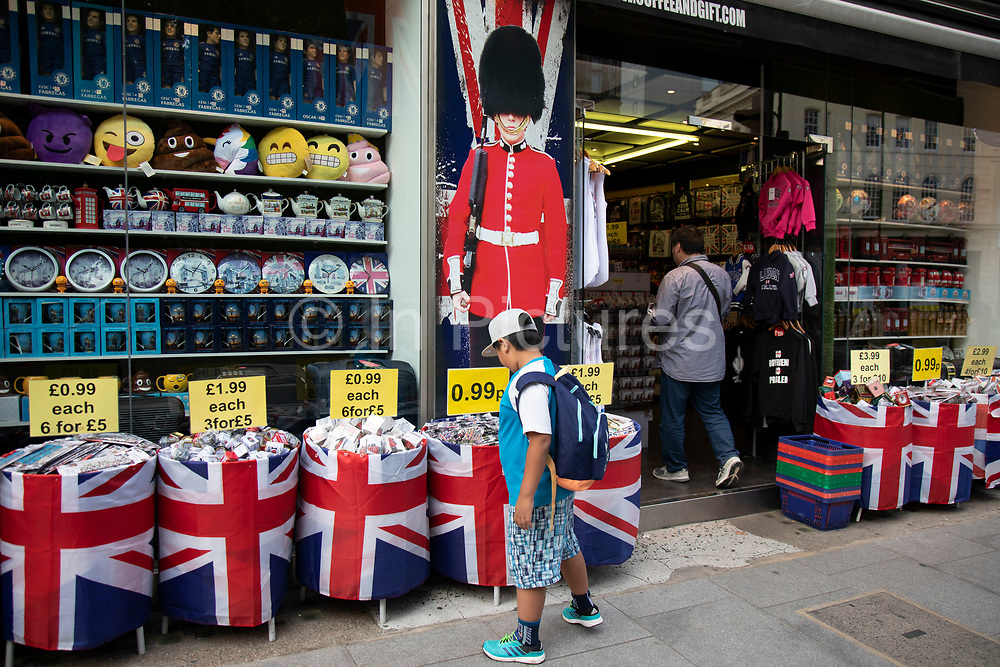 Coldstream guard in uniform and bear skin hat appears on a poster outside a tourist shop in central London, England, United Kingdom. This is an iconic symbol of Britishness for the tourism industry and for Britians identity.