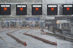 © Licensed to London News Pictures  21/12/2020. Dover, UK. The Port of Dover check in lanes are empty and closed. A major police operation is underway in Kent as Operation Stack is implemented on the M20 due to the Port of Dover and Channel Tunnel having to close in response to France closing its borders to the UK. All freight and passenger traffic have been banned for 48 hours due to the new mutant strain of the Coronavirus in England. traffic. Photo credit:Grant Falvey/LNP