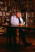 Robert Hughes, Author and Art Critic at his home library in Soho, New York City.