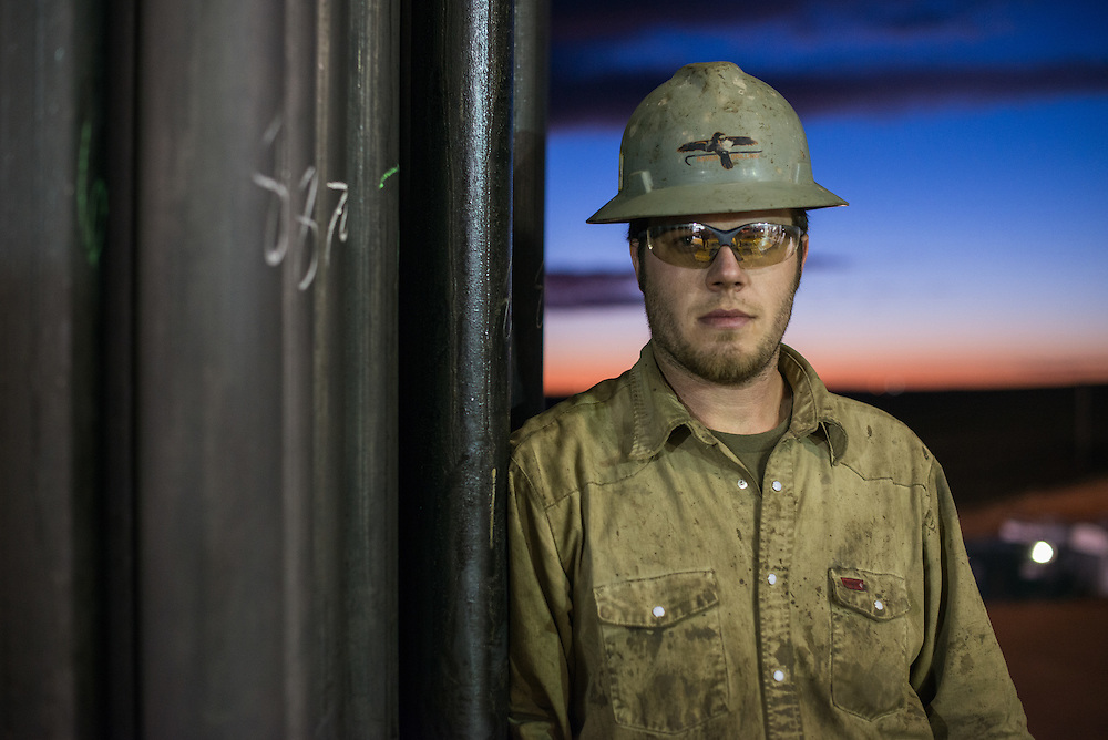 Peter Williams, a motorman stops for a moment to pose for a photo on the Raven Drilling rig just outside of Watford City, N.D., Sept 20, 2013. In 2008 the North Dakota oil boom started its ongoing period of extraction of oil from the Bakken formation. Shale gas reserves has given the United States more independence over other nations such as Venezuela and countries in the Middle East.  Photo Ken Cedeno