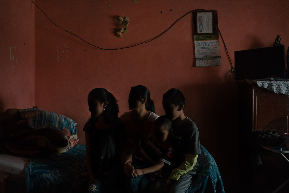 """A family that unsuccessfully looked for asylum in the U.S. poses for a portrait in their home in the outskirts of Juan Aldama, Zacatecas, Mexico. In their neighborhood, there were robberies, disappearances and street-corner drug sales. Then, one night in July 2019, gunmen ambushed and killed the police chief. Officers vanished from the streets. """"My husband told me, 'We have to get out of here,' """" she said. """"He told me, 'Don't you see there are no police? Don't you see they're frightened? Who will protect us?' """"She had heard that the United States was offering asylum to Mexicans in danger. The family stuffed some clothes into backpacks and boarded a bus for the 600-mile trip to the Texas border. They returned home after they were asked to wait for the application in Mexico."""