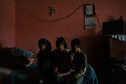 "A family that unsuccessfully looked for asylum in the U.S. poses for a portrait in their home in the outskirts of Juan Aldama, Zacatecas, Mexico. In their neighborhood, there were robberies, disappearances and street-corner drug sales. Then, one night in July 2019, gunmen ambushed and killed the police chief. Officers vanished from the streets. ""My husband told me, 'We have to get out of here,' "" she said. ""He told me, 'Don't you see there are no police? Don't you see they're frightened? Who will protect us?' ""She had heard that the United States was offering asylum to Mexicans in danger. The family stuffed some clothes into backpacks and boarded a bus for the 600-mile trip to the Texas border. They returned home after they were asked to wait for the application in Mexico."