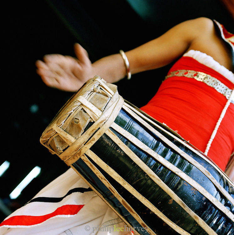 A musician playing a traditional drum in Sri Lanka