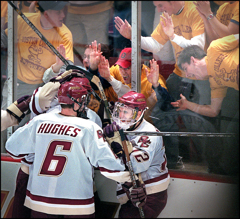1/27/01.  BC VS MAINE.  #12 BRIAN GIONTA IS SWARMED BEHIND THE NET AFTER SCORING HIS 4TH GOAL OF THE GAME.  STAFF PHOTO BY MICHAEL SEAMANS SAVED IN PHOTO 2