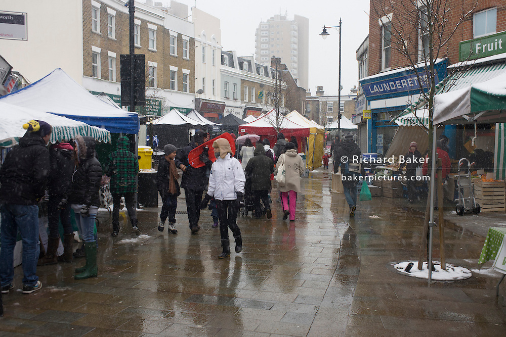 Herne Hill farmer's market trade during snowy winter's day.