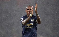 Manchester United's Ashley Young applauds the away fans after the Premier League match at the Emirates Stadium, London.