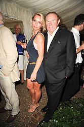ANDREW NEIL and LISA HILTON at the Apollo Magazine Summer Party held at 22 Old Queen Street, London, SW1 on 29th June 2010.