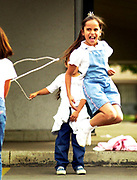 """11-21-01 ch stqandalonejump.jpg (Marilynn Young/Ontario Daily Bulletin) Third grad student Claudia Cavajal,8, gets into skipping rope to the song """"Ice Cream Soda"""" during recess at El Rancho Elementary in Chino on Nov. 21, 2001. The rope is being held by her sister, Neydis Carvajal,6, and Bertha Castellanos,8, (far left)."""