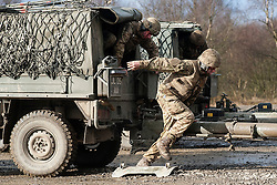 Troops dismount from their Pinzgauer 716 all-terrain vehicle to un hitch the L118 105mm light gun during exercise Steel Sabre. A large Scale military live fire exercise on Otterburn Training Area it involves 1400 troops the majority from the Royal Artillery 1st Artillery Brigade and brings all the components of an effective Artillery group together to train in delivering firepower on the battlefield.<br /> <br />   02 March 2017 <br />   Copyright Paul David Drabble<br />   www.pauldaviddrabble.co.uk