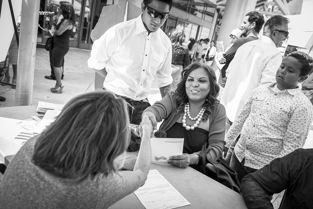 New citizens register to vote only minutes after being sworn-in as new United States citizens.