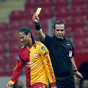 Referee's Bunyamin GEZER (R) show the yellow card to Galatasaray's Juan Pablo PINO (L) during their Turkish superleague soccer derby match Galatasaray between Trabzonspor at the TT Arena in Istanbul Turkey on Sunday, 10 April 2011. Photo by TURKPIX