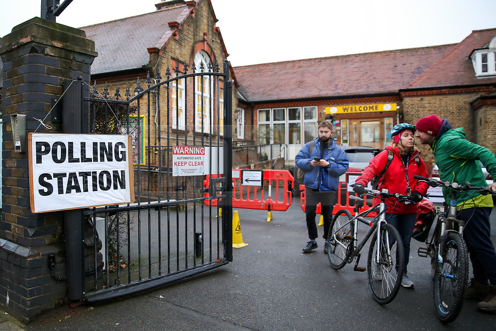 © Licensed to London News Pictures. 12/12/2019. London, UK. Voters leave a polling station in Haringey, north London after voting in the UK General Election. Polling stations have opened as the nation votes to decide the next UK Government in the first December election since 1923. Photo credit: Dinendra Haria/LNP
