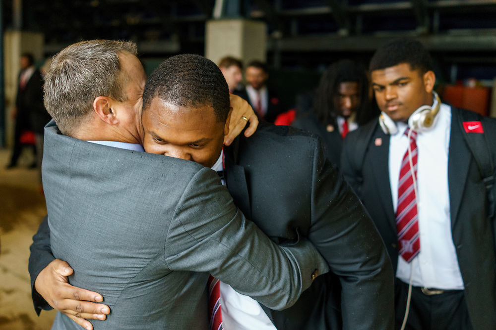 Annapolis, Maryland - October 08, 2016: Tom Herman, the University of Houston's head coach, hugs and kisses  B.J. Singleton senior defensive tackle before their game against Navy, in Annapolis, Md., Saturday October 8, 2016.<br /> <br /> <br /> Before every game, Tom Herman, the University of Houston's head coach, hugs and kisses each of his players during the walk from the bus to the locker room .<br /> <br /> The Cougars lost their first game of the season to the Midshipmen 40 - 46.<br /> <br /> <br /> CREDIT: Matt Roth for The New York Times<br /> Assignment ID:  30196504A