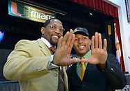 Ray Lewis III, right, and his father, former Baltimore Ravens linebacker Ray Lewis Jr., make the U sign with their hands, representing the University of Miami, after a national signing day ceremony in the Lake Mary Prep auditorium in Lake Mary, Fla., Wednesday, Feb. 6, 2013. Lewis III signed a letter of intent to play football at the University of Miami, where his father also played college football. (AP Photo/Phelan M. Ebenhack)