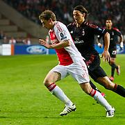 NLD/Amsterdam/20100928 - Champions Leaguewedstrijd Ajax - AC Milan, Siem de Jong in duel met Zlatan Ibrahimovic
