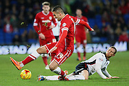 Paul Green of Rotherham tackles Federico Macheda of Cardiff. Skybet football league championship match, Cardiff city v Rotherham Utd at the Cardiff city stadium in Cardiff, South Wales on Saturday 6th December 2014<br /> pic by Mark Hawkins, Andrew Orchard sports photography.
