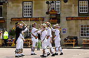 Morris Men perform traditional dance in Middle England at Uppingham Market Square, Rutland, England, UK