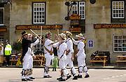 Morris Men perform traditional dance in Middle England at Uppingham Market Square, Rutland, England, UK