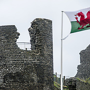 The Welsh flag blows in the wind atop the remains of the castle in Aberystwyth on the western coast of Wales.