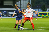 Emma Mitchell (#3) of Scotland challenges for the ball with Viola Calligaris (#18) of Switzerland during the 2019 FIFA Women's World Cup UEFA Qualifier match between Scotland Women and Switzerland at the Simple Digital Arena, St Mirren, Scotland on 30 August 2018.