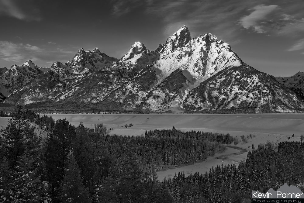 The Tetons glow in the light of sunrise on a frosty morning while the Snake River flows quietly below. It is this exact view that I used to create my logo/watermark that I put in the corner of every picture I upload. One of the reasons the Tetons are so majestic is because this range has no foothills. The mountains rise abruptly 7,000 feet above the valley floor in only about 3 miles. On long winter nights cold air tends to slide down the steep slopes and becomes trapped under an inversion layer in the Jackson Hole Valley. With the Tetons to the west, Absarokas to the north, and the Gros Ventre mountains to the east, the air has nowhere to go. This leads to some seriously cold temperatures. In the last month alone it has reached -20°F or colder on 7 mornings. In 1933 the temperature here dropped to a bone-chilling -66°F, making it among the coldest temperatures ever measured in the US outside of Alaska.