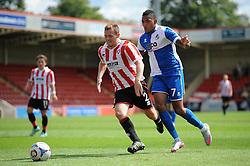 Christian Montano of Bristol Rovers chases down Jack Barthram of Cheltenham Town - Mandatory by-line: Dougie Allward/JMP - 25/07/2015 - SPORT - FOOTBALL - Cheltenham Town,England - Whaddon Road - Cheltenham Town v Bristol Rovers - Pre-Season Friendly