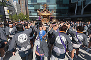 People prepare to carry a mikoshi, or portable shrine, in the bi-annual Kanda matsuri (festival). Chiyoda Ward, Tokyo, Japan Sunday May 10th 2015. Over 200 mikoshi are carried through the streets of central Tokyo every 2 years in this spring festival
