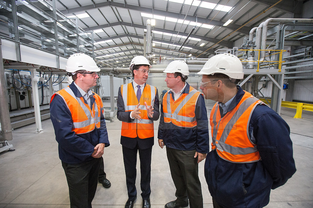 © Licensed to London News Pictures . 04/10/2013 . St Helens , UK . ED MILIBAND , (2nd from left) the leader of the Labour Party , tours Pilkington Glass ' Cowley Hill Works in St Helens this morning (Friday 4th October 2013) . The production line builds energy efficient glazing . The opposition leader is currently embroiled in a row with the Daily Mail after it published a story stating that his father , Ralph Miliband , hated Great Britain . Photo credit : Joel Goodman/LNP