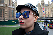 Anti Brexit pro Europe demonstrator has the EU flag reflected in her sunglasses in Westminster on 26th March 2019 in London, England, United Kingdom. With the date of the UK leaving the European Union extended, the pro EU protest continues as MPs from all sides try to gain control of the process.