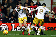 Florian Jozefzoon of Brentford (c) is tackled by Morgan Fox (L) & Jacob Butterfield of Sheffield Wednesday (R). EFL Skybet football league championship match, Brentford v Sheffield Wednesday at Griffin Park in London on Saturday 30th December 2017.<br /> pic by Steffan Bowen, Andrew Orchard sports photography.