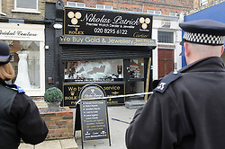 © Licensed to London News Pictures. 19/03/2013.Smash and grab robbery,Chislehurst, South East London this afternoon 19.03.2013..A gang of men armed with an axe and a sledge hammer have committed a Smash and grab robbery on Nikolas Patrick jewellery shop in Chislehurst High Street in South East London. .Photo credit : Grant Falvey/LNP