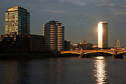 Millbank Tower glowing in the evening sun looking north across the River Thames and Vauxhall Bridge in London, England, United Kingdom. Once known as Vickers Tower.