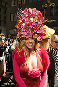 A woman wearing an outsized hat covered in butterflies.