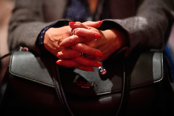 © Licensed to London News Pictures. 26/09/2016. Liverpool, UK. Red painted nails on the hands of LAURA ALVAREZ, wife of Labour leader Jeremy Corbyn, as she watches Shadow Chancellor John McDonnell deliver a speech at day two of the Labour Party Annual Conference, held at the ACC in Liverpool, merseyside, UK. Photo credit: Ben Cawthra/LNP