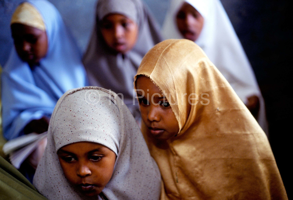 Girls reading a Koran in a Madrassa in Broua, Somaliland. Boys and girls are educated seperately.