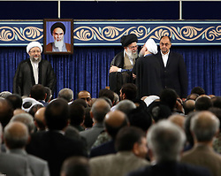 Handout photo - Iranian supreme leader Ayatollah Ali Khamenei shows him (2L) kisses President Hassan Rouhani (C), as deputy chief of supreme leader's office Vahid Haghanian (R) looks on during Rouhani's swearing in ceremony to serve his second term in Tehran, Iran, on August 3, 2017. Rouhani vowed to continue his efforts to end the country's isolation as he was sworn in by supreme leader Ayatollah Ali Khamenei to serve his second term following his re-election in May. Photo via Parspix/ABACAPRESS.COM