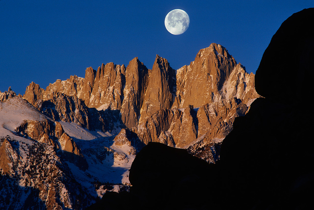Moonset Over Mount Whitney viewed from Alabama Hills,, morning light, Eastern Sierra Mountains,  Sequoia National Park, California, USA.