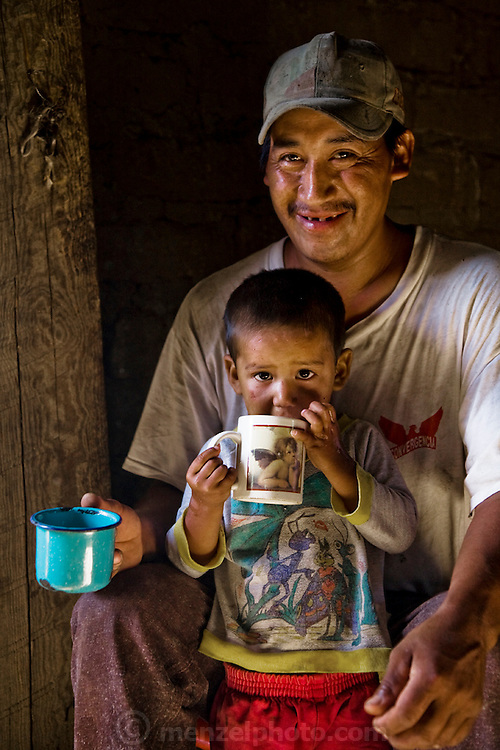 José Angel Galaviz Carrillo, a rancher of Pima heritage, having tea with his son Favien at their home in the Sierra Mountains, near Maycoba, in the Mexican state of Sonora. (From the book What I Eat: Around the World in 80 Diets.)