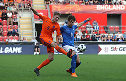 Netherlands' Wouter Burger (left)and Italy's Edoardo Vergani battle for the ball during the UEFA European U17 Championship final at the AESSEAL New York Stadium, Rotherham.