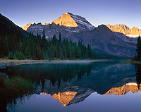 Mount Gould 9,553 ft (2,912 m) reflected in Josephine Lake, Glacier National Park Montana USA